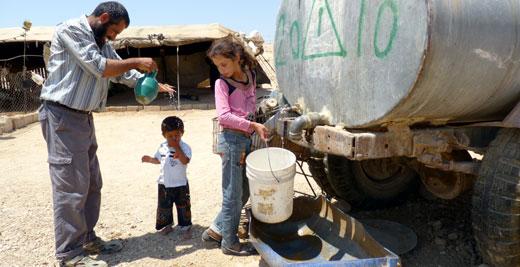 Palestinian residents of Khirbet a-Duqaiqah, South Hebron Hills, 19 August 2012. Photo: Nasser Nawaj'ah, B'Tselem.