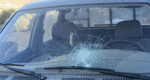 Ghatib Na'asan's car after the assault. Photo: Iyad Hadad, B'Tselem, 26.10.13