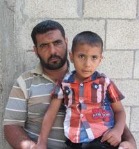 Tawfiq Abu Jame' and his son Nur a-Din. Photo: Khaled  al-'Azayzeh, 16 Sept. 2014