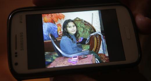 Family cellphone photo of Hifaa, daughter of Tawfiq Abu Jame'. Photo: Anne Paq, Activestills.org, 15 Nov. 2014