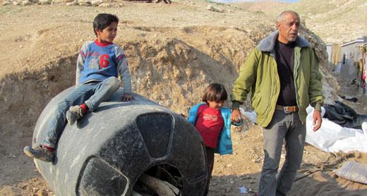 Community leader Muhammad Ka'abneh and two of his sons. Photo: 'Amer al-Aruri, B'Tselem, 18 Jan. 2015. Click on photo to enlarge