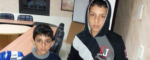 Khatab Abu Mariyah, 12, and Yusef 'Alameh, 8, at the Palestinian DCO after their interrogation