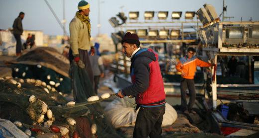 Fishermen at Gaza's fishing port. Photo by Suhaib Salem, Reuters, 4 April 2016
