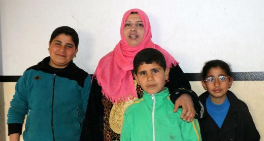 Samirah 'Abd a-Dayem with her children. Photo by Muhammad Sabah, B'Tselem, 27 Feb. 2017