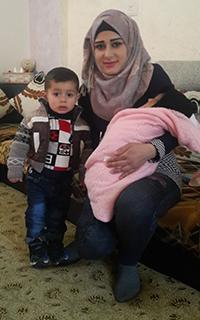 Rawnad Hanani and her children. Photo by Salma a-Deb'i, B'Tselem