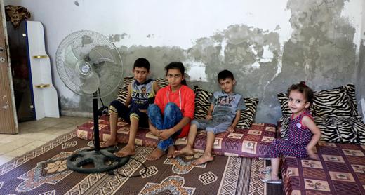 Four of Khulud Jaber's children at home, Nuseirat Refugee Camp. Photo by Khaled al-'Azayzeh, B'Tselem, 7 July 2017