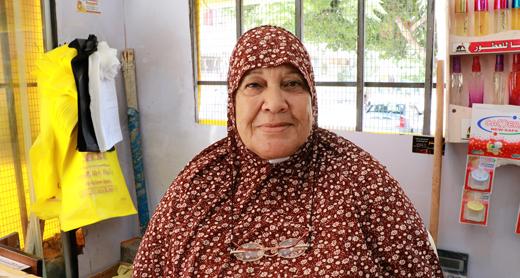 Maryam Abu Yusef at the family grocery store. Photo: Khaled al-'Azayzeh, B'Tselem, 13 August 2017