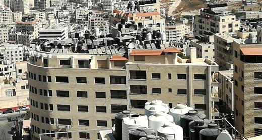 Water tanks on the roofs of Nablus homes. Photo: Salma a-Deb'i, B'Tselem, 13 September 2017.