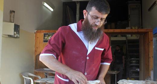 Khader 'Adnan at his bakery. Photo by Oren Ziv, activestills.org, 21 June 2013.