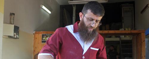 Khader 'Adnan at his bakery. Photo by Oren Ziv, activestills.org, 21 June 2013
